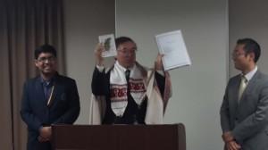 Shotoku-Gakuen---Japan-School-Principal-displaying---Trishit's-Poetry-book-and-portfolio-1